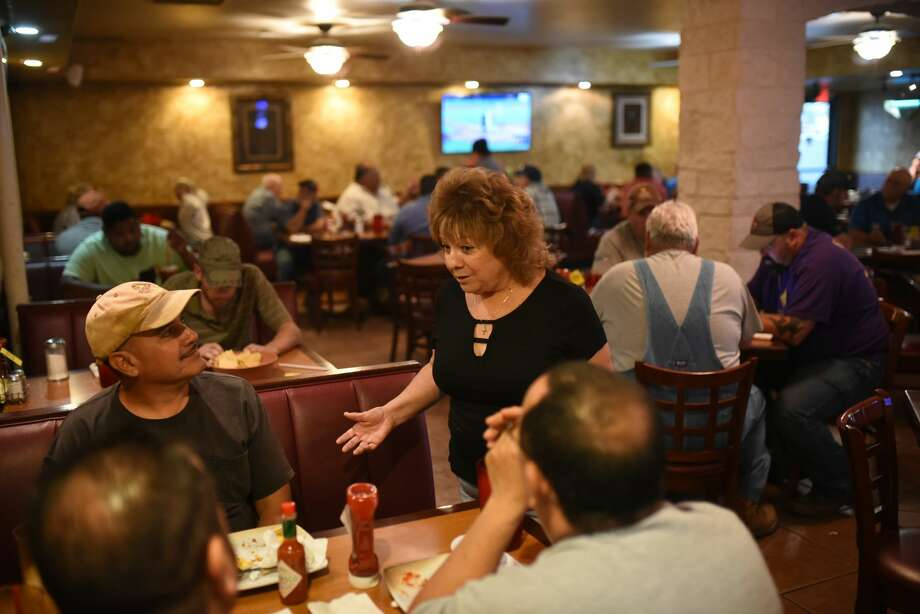 Margie Pena, manager of the Old Mill Restaurant, talks to customers at the restaurant July 31, 2018 in Pecos. James Durbin/Reporter-Telegram Photo: James Durbin