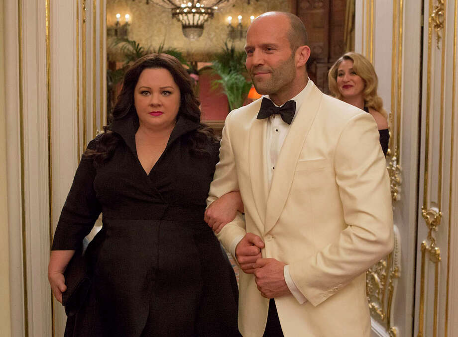 "Susan Cooper (Melissa McCarthy) and her fellow CIA operative Rick Ford (Jason Statham) pose as a ""happy"" couple as they go deep undercover to stop an arms dealer in ""Spy."" Illustrates FILM-SPY-ADV05 (category e), by Ann Hornaday © 2015, The Washington Post. Moved Wednesday, June 3, 2015. (MUST CREDIT: Larry Horricks/Twentieth Century Fox.) Photo: HANDOUT / THE WASHINGTON POST"