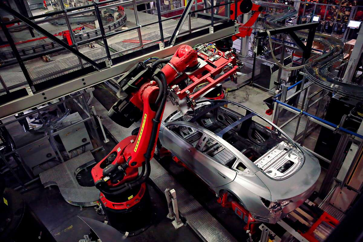A Tesla Model 3 is seen on the body line at the Tesla factory on Wednesday, July 18, 2018 in Fremont, Calif.