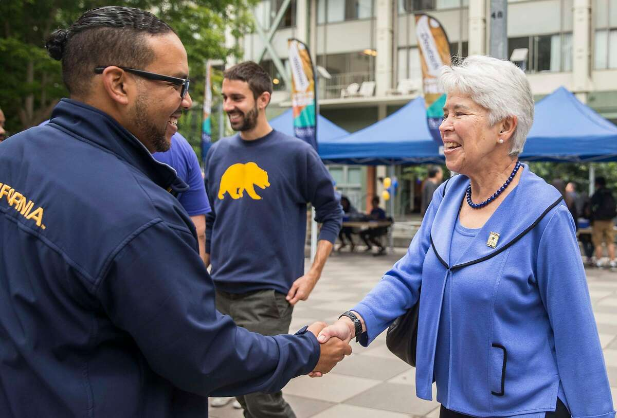 UC Berkeley Chancellor Carol Christ greets David Surratt as she walks through the Unit 1 Residential Hall during move-in day in Berkeley, Calif. Tuesday, Aug. 14, 2018.