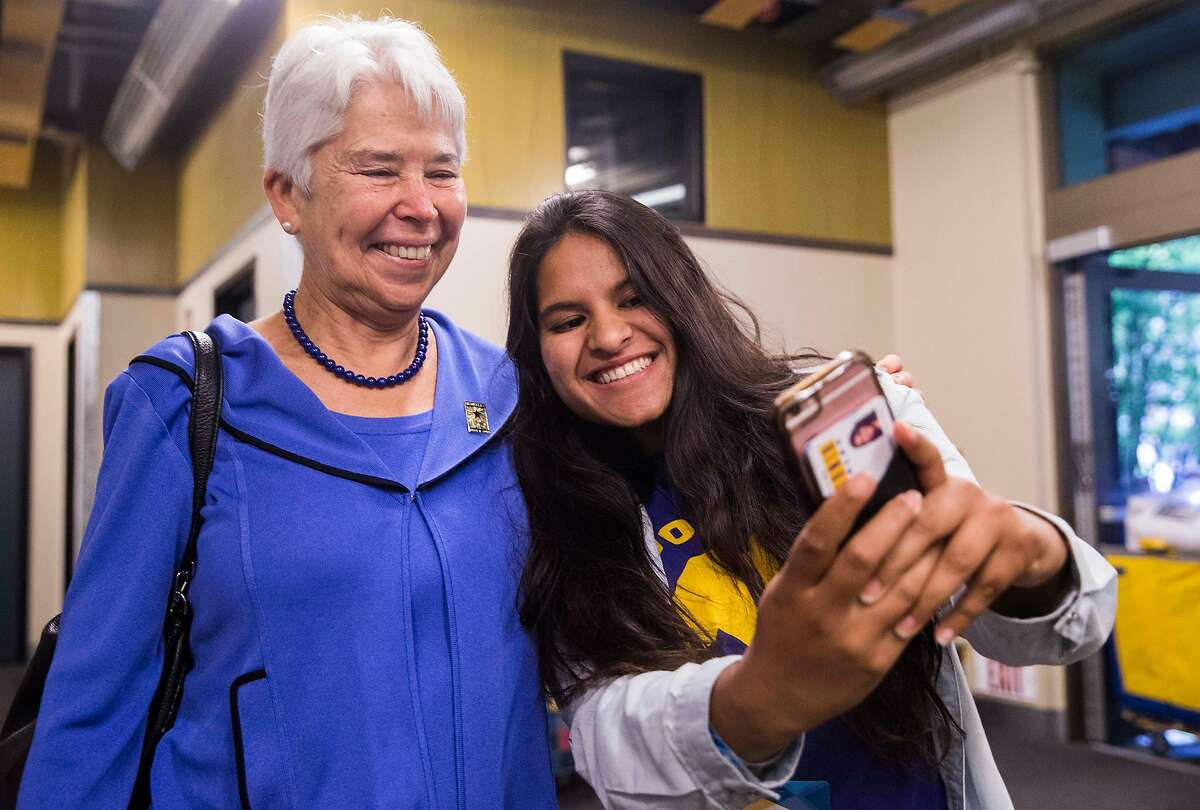 UC Berkeley Chancellor Carol Christ takes a selfie with RA Medhavi Goel during move-in day at the Unit 2 Residential Hall in Berkeley, Calif. Tuesday, Aug. 14, 2018.