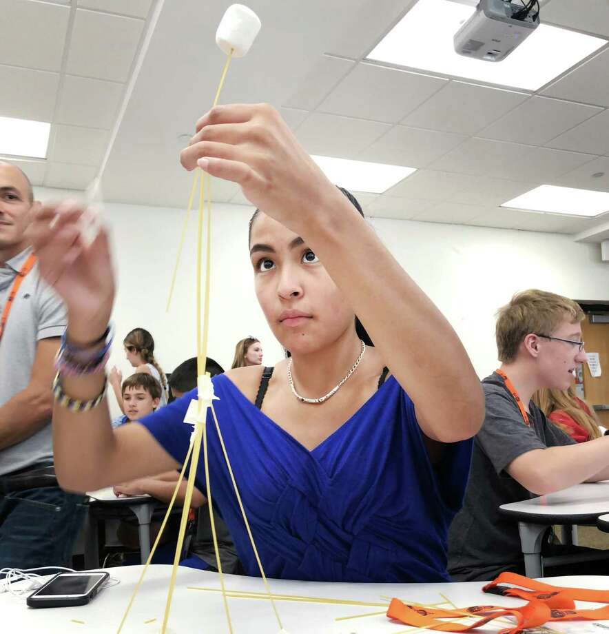 Briana Ortiz, 13, a student in the Early College Studies Program, leads her team in the Marshmallow Challenge exercise to build team-work and collaboration during a visit by those students to Stamford High School just prior to starting their freshman year at the school in Stamford, Conn., Friday, August 17, 2018. Photo: Bob Luckey Jr. / Hearst Connecticut Media / Greenwich Time