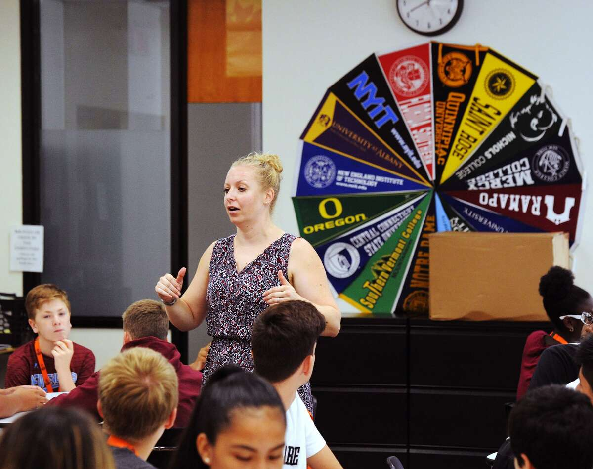 Kristin Veenema, director of the Early College Studies Program, speaks with those students visiting Stamford High School just prior to starting their freshman year at the school in Stamford, Conn., Friday, August 17, 2018.