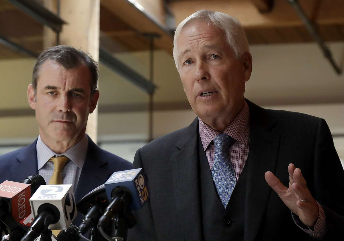 Attorneys Robert Arns, right, and Jonathan Davis, representing the family of Nia Wilson, speak at a news conference in San Francisco, Friday, Aug. 17, 2018. The family of Nia Wilson, who was stabbed to death at a subway station in Oakland, Calif., on July 22, 2018, is taking the first legal step toward suing the Northern California public transit system. Arns said his law firm delivered a legal claim Friday to the Bay Area Rapid Transit on behalf of the family of 18-year-old Wilson. (AP Photo/Jeff Chiu)