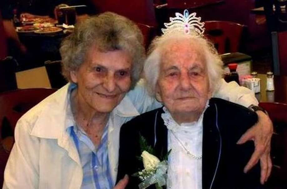 Jennie Recchia Marchitto, right, shown here with her niece Justina Marchitto, wore a tiara at her 100th birthday party. Marchitto, who for years before moving in with her daughter in Guilford was West Haven's oldest active Republican, died Tuesday at age 102. She was laid to rest Friday. Photo: Contributed / Marchitto Family