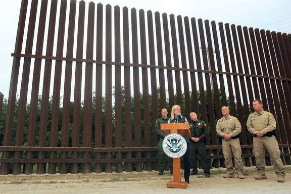 United States Department of Homeland Security Secretary Kirstjen Nielsen speaks to the local news media against the backdrop of the border wall Dec 13, 2017, in Hidalgo, Texas. She said she wanted more wall built soon — apparently regardless of whether it cuts up private property.