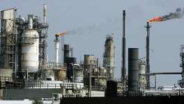 An oil refinery on Galveston Bay in Texas City in 2005. Federal rules on ethanol threaten refinery jobs unless Congress acts.