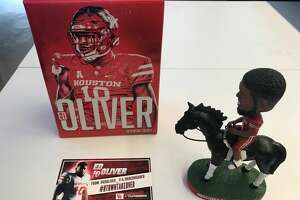 A look at the Ed Oliver bobblehead that University of Houston mailed to college football media members.