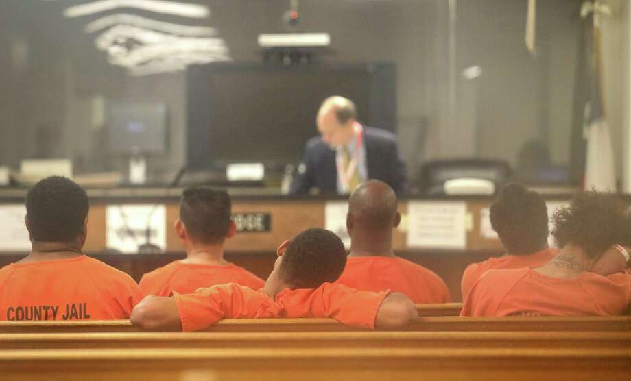 Defendants — shown here in Houston last year — should have the benefit of counsel even at initial bail hearings. Too often in Bexar County, they do not. Photo: Jon Shapley /Houston Chronicle / © 2017 Houston Chronicle