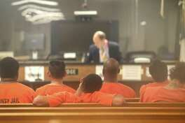 Defendants - shown here in Houston last year - should have the benefit of counsel even at initial bail hearings. Too often in Bexar County, they do not.