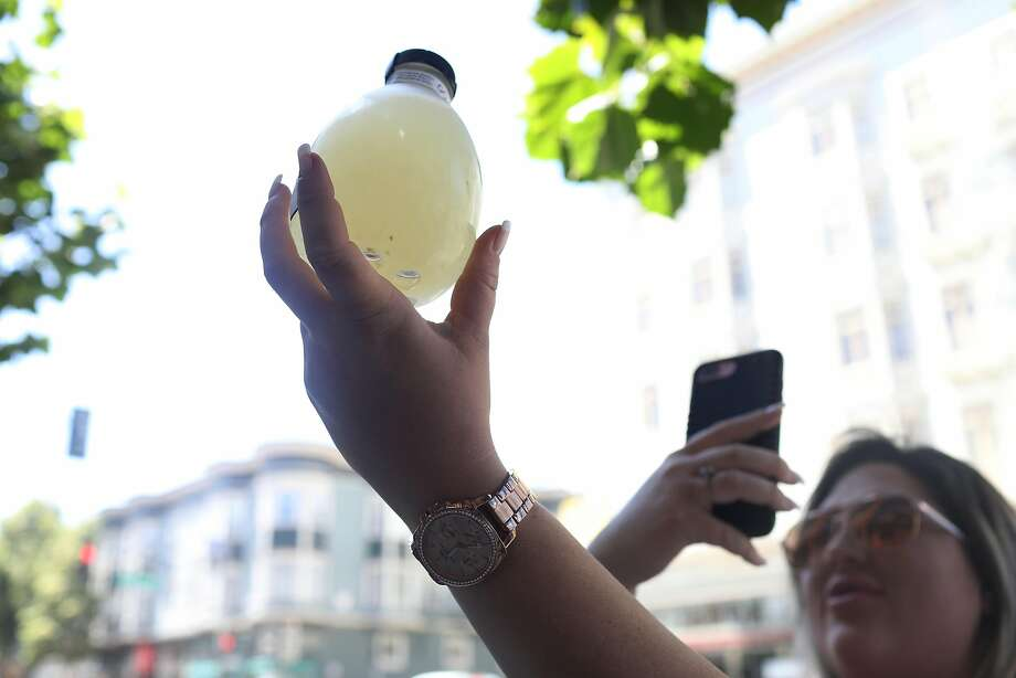 Paige Danekind of Fort Collins, Colo., takes a photo of her Gourmonade lemonade in San Francisco, known for its high prices and its black owner. Photo: Lea Suzuki / The Chronicle