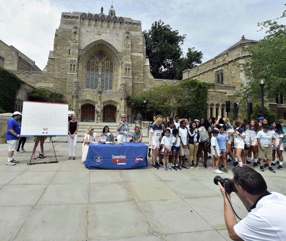Connecticut Open tournament director Anne Worcester starts the main draw ceremony Friday at Yale University's Sterling Library in New Haven.