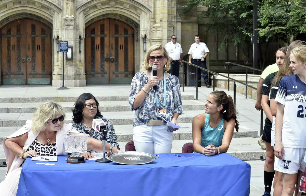 Connecticut Open tournament director Anne Worcester, third from left, with WTA supervisor Donna Kelso, new Yale Athletic Director Victoria Chun, and 10th ranked tennis player Julia Gorges talk during the main draw ceremony Friday at Yale University's Sterling Library in New Haven.