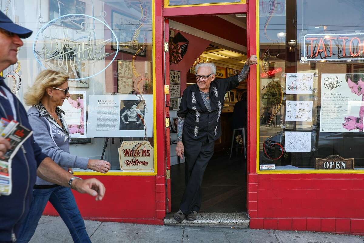 Lyle Tuttle greets people as they pass by while posing for a portrait in his tattoo shop in San Francisco, California, on Tuesday, Aug. 14, 2018.