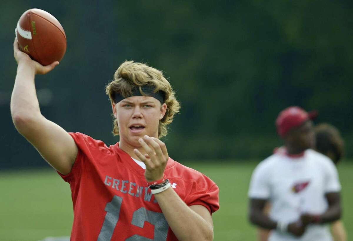 Greenwich quarterback Gavin Muir tosses warm up passes on the first day of practice Friday in Greenwich.