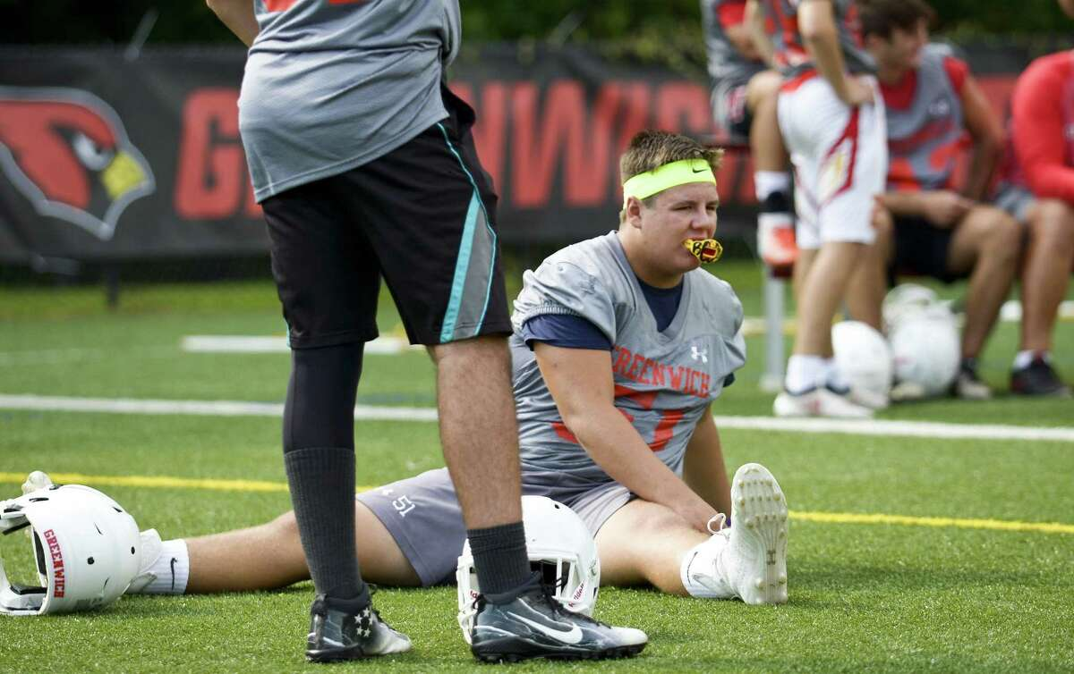 Defensive tackle Joe Kraninger (51) stretches out on the first day of practice for the Greenwich High School football team on August 17, 2018 in Greenwich, Connecticut.