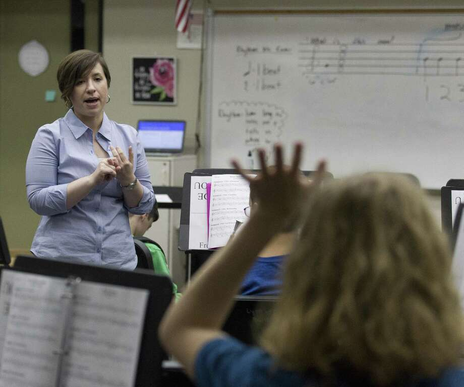 Band Director Emily Hicks instructs students during honor band class at Lynn Lucas Middle School on Thursday, Aug. 16, 2018, in Willis. The school's honor band is one of eight middle school bands in the nation to be accepted to the Music For All National Festival in Indianapolis, Indiana. Photo: Jason Fochtman, Staff Photographer / Staff Photographer / © 2018 Houston Chronicle