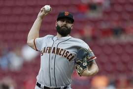 San Francisco Giants starting pitcher Casey Kelly throws against the Cincinnati Reds during the first inning of a baseball game Friday, Aug. 17, 2018, in Cincinnati. (AP Photo/Gary Landers)