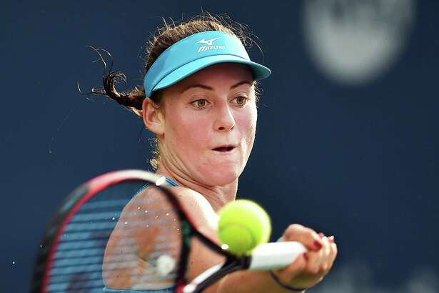 Tamara Zidansek returns to Maria Sanchez in their qualifying-round match Friday at the Connecticut Open at the Connecticut Tennis Center at Yale in New Haven. Zidansek won, 7-5, 7-6.