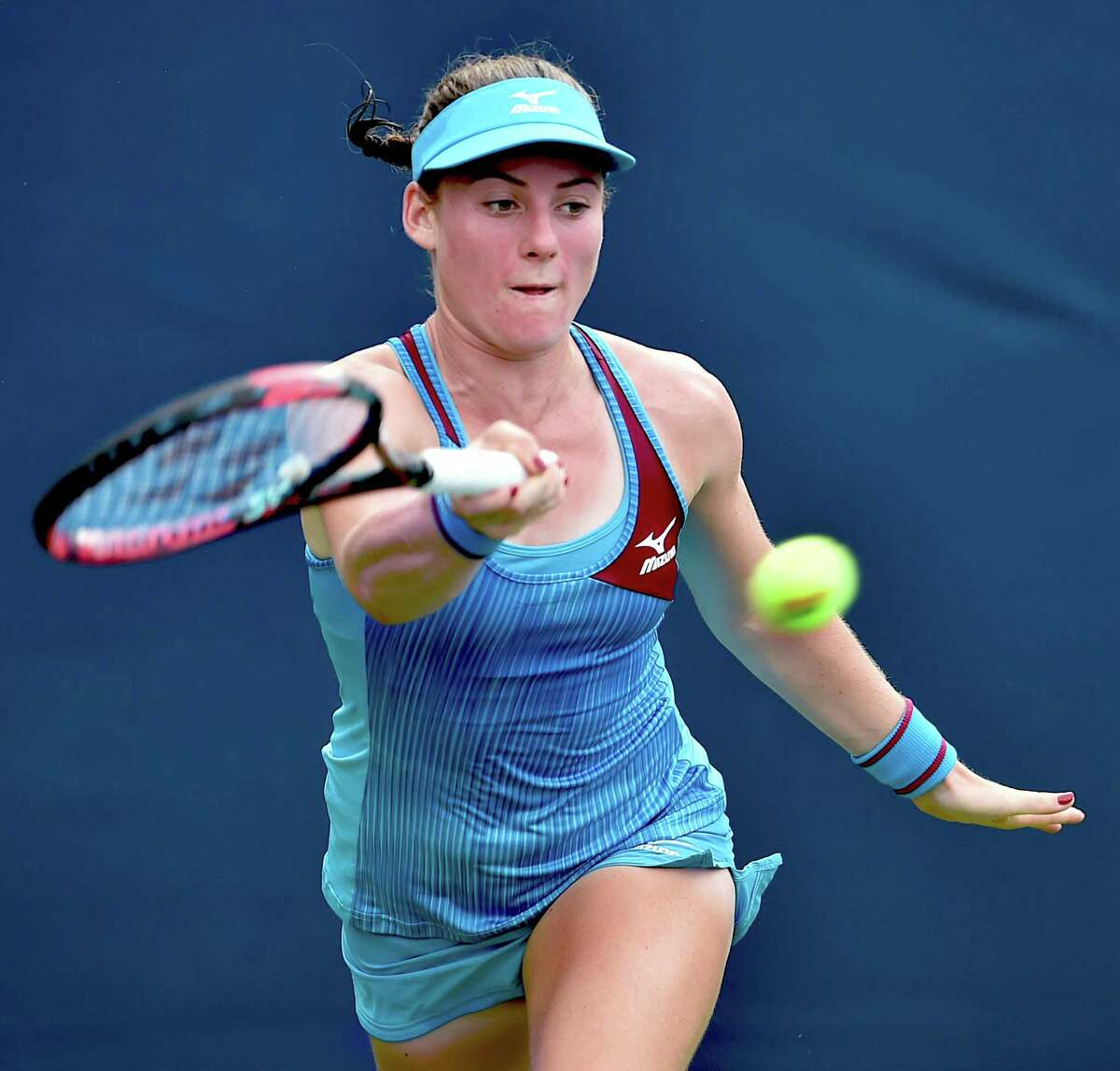 Tamara Zidansek returns to Maria Sanchez in the qualifying round Friday at the Connecticut Open in New Haven. Zidansek won, 7-5, 7-6.