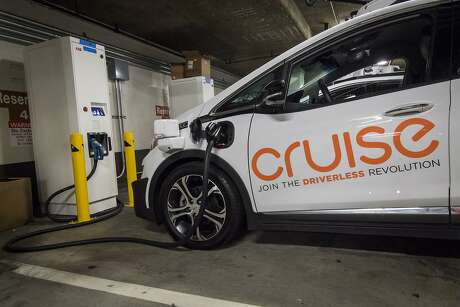 A General Motors Cruise autonomous test vehicle is parked at a new charging station in San Francisco. Ride services are hiring consulting firms and former City Hall staffers to help them negotiate any new regulations. Photo: David Paul Morris / Bloomberg