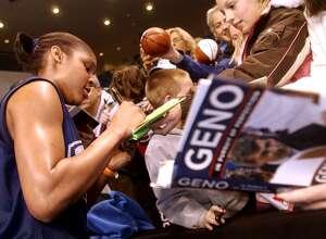 UConn forward Maya Moore signs autographs following practice at Bridgeport Arena at Harbor Yard in 2008.