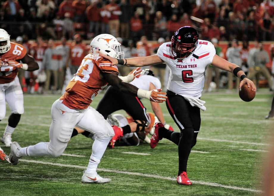AUSTIN, TX - NOVEMBER 24: Texas Tech Red Raiders QB McLane Carter (6) stiff arms Texas Longhorns LB Gary Johnson (33) during 27 - 23 win over the Texas Longhorns on November 24, 2017 at Darrell K Royal-Texas Memorial Stadium in Austin, TX. (Photo by John Rivera/Icon Sportswire via Getty Images) Photo: Icon Sportswire Via Getty Images / ©Icon Sportswire (A Division of XML Team Solutions) All Rights Reserved