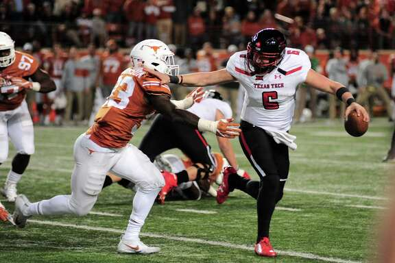 AUSTIN, TX - NOVEMBER 24: Texas Tech Red Raiders QB McLane Carter (6) stiff arms Texas Longhorns LB Gary Johnson (33) during 27 - 23 win over the Texas Longhorns on November 24, 2017 at Darrell K Royal-Texas Memorial Stadium in Austin, TX. (Photo by John Rivera/Icon Sportswire via Getty Images)