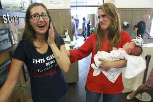 Restaurant owner Amanda Stover takes the baby as Falon Margaret Griffin returns to the Chick-fil-A with her baby Gracelyn Mae Violet, born in the restroom of the restaurant one month earlier, on August 17, 2018.