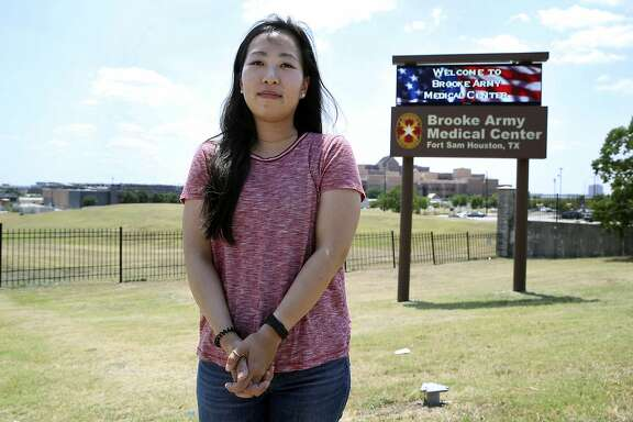 Yea Ji Sea, an Army specialist from South Korea who was discharged Friday at Joint Base San Antonio - Fort Sam Houston, stands on the sidewalk in front of the post on August 3, 2018.