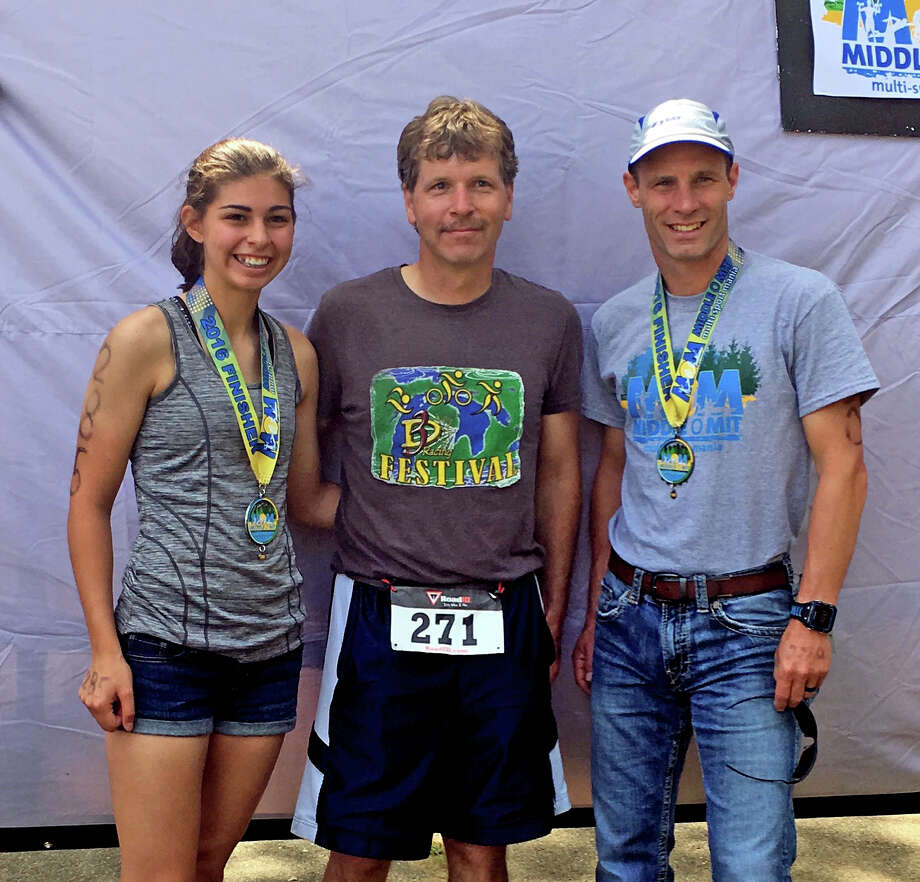 Jelena Prescott is seen here with her father Mark Prescott (middle) and Trever Engler (right). Prescott credits her father and Engler as people who have helped her with a successful running career at Bad Axe. On July 23, Engler tragically passed away after injuries sustained in an aircraft accident. (Courtesy Photo)