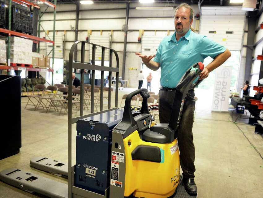 Production manager Daniel Connelly demonstrates their gen drive fuel cell powered stand-up fork truck application during the opening of Plug Power's new warehouse and fuel cells assembly facility Friday August 17, 2018 in Clifton Park, NY. (John Carl D'Annibale/Times Union)