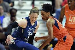 Minnesota Lynx guard Lindsay Whalen regains control of the ball after having it poked away by Sun guard Jasmine Thomas on Friday in Uncasville
