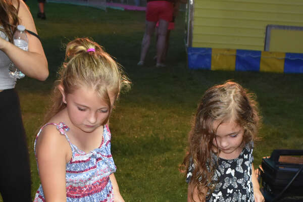 People come out to enjoy The Winsted Firemans Carnival, despite rain. Games, Food, Bingo, Dunk Tank, Beer Garden and rides entertain all ages.