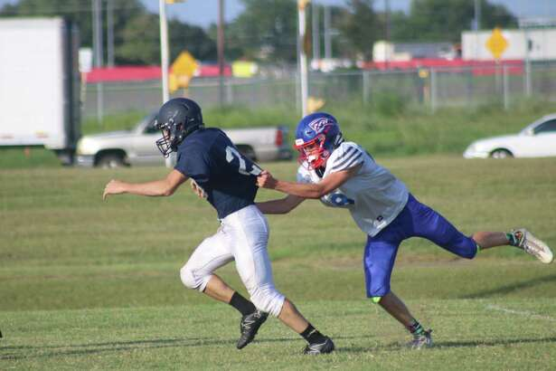 Despite a FBCA defender grabbing a fistful of his jersey, West Hardin running back Randon Kelley is headed for his fourth touchdown in Friday night's scrimmage.