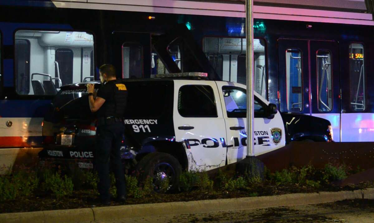 A Houston police vehicle collided with a Metro Rail train in Midtown on Friday, Aug. 17, 2018.