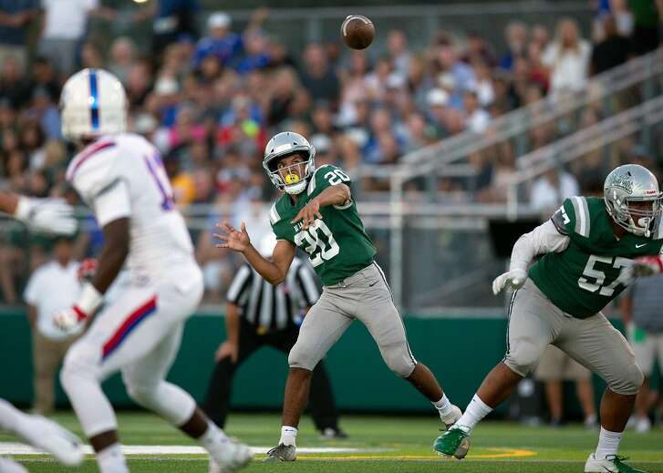 De La Salle quarterback Dorian Hale (20) looses a pass against Folsom during the first quarter of a high school football game on Friday, Aug. 17, 2018 in Concord, Calif.