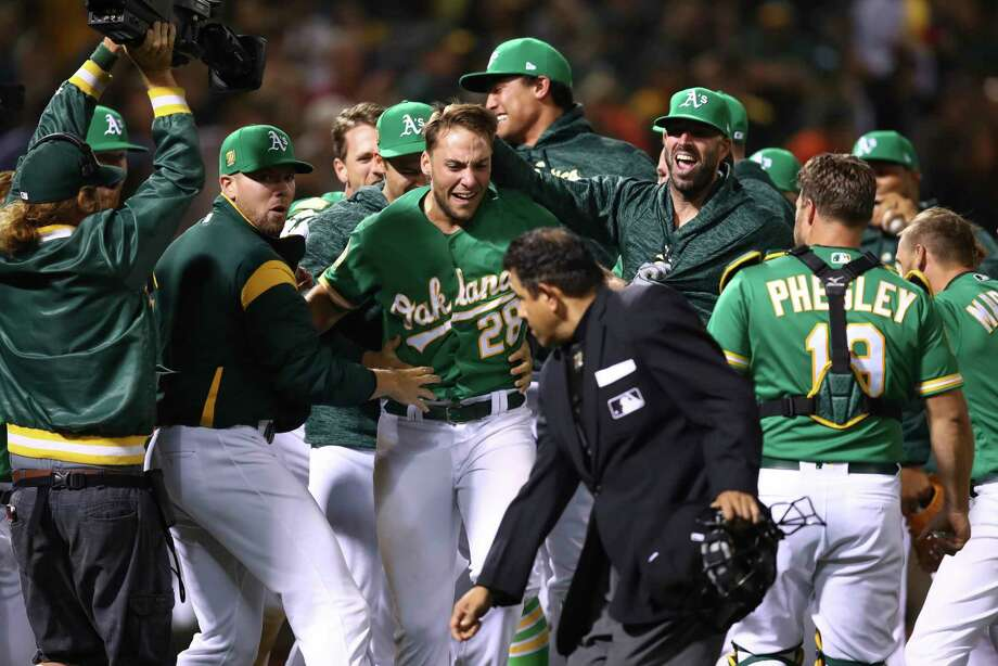 online store c4e44 a4f81 Walk-off homer in 10th lifts A's over Astros - Houston Chronicle