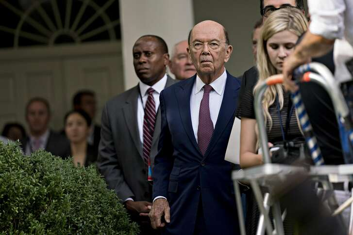 Wilbur Ross, U.S. commerce secretary, center, listens during a joint statement with U.S. President Donald Trump and Jean-Claude Juncker, president of the European Commission, not pictured, in the Rose Garden of the White House in Washington, D.C., U.S., on Wednesday, July 25, 2018. Trump reached an agreement today with Juncker aimed at averting a transatlantic trade war, easing tensions stoked by Trump's threat to impose tariffs on car imports. Photographer: Andrew Harrer/Bloomberg