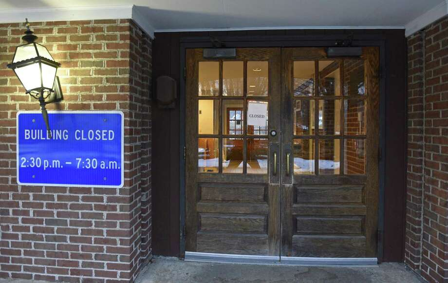 A closed sign on the door to the Welcome Center building off I-84 in Danbury in this 2017 file photo. Photo: H John Voorhees III / Hearst Connecticut Media / The News-Times