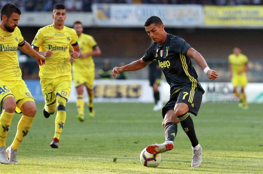 Juventus' Cristiano Ronaldo controls the ball during the Serie A soccer match between Chievo Verona and Juventus, at the Bentegodi Stadium in Verona, Italy, Saturday, Aug. 18, 2018. (AP Photo/Antonio Calanni) Photo: Antonio Calanni, Associated Press / Copyright 2018 The Associated Press. All rights reserved