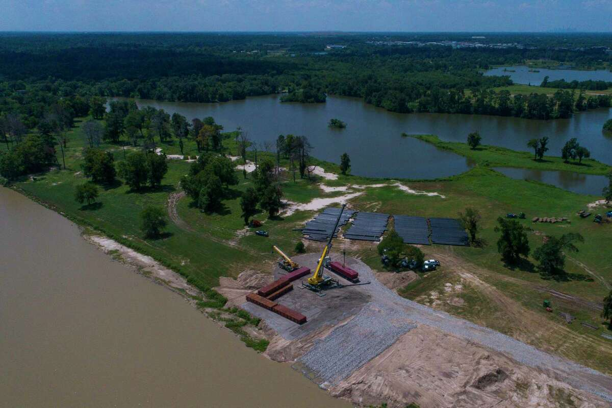 Contractors stage equipment for the Army Corps of Engineers' planned dredging of the West Fork of the San Jacinto River east of Highway 59, Wednesday, Aug. 1, 2018 in Humble.