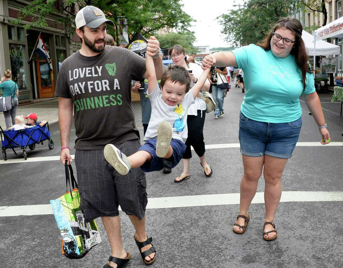 Three-year-old Dylan Anauo of Clifton Park gets a lift from parents Ben and Courtney during a trip to the Troy Farmers' Market Saturday August 18, 2018 in Troy, NY. (John Carl D'Annibale/Times Union)