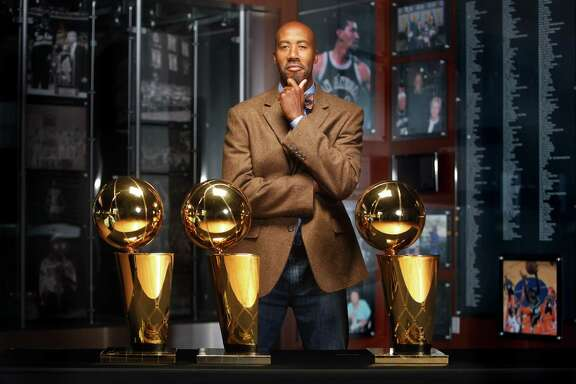 Bruce Bowen poses Wednesday Dec. 7, 2011 at the AT&T Center with the three Larry O'Brien Championship Trophies he earned while he played with the Spurs. Bowen is being inducted into the 2012 class of the San Antonio Sports Hall of Fame.    (William Luther/wluther@express-news.net)
