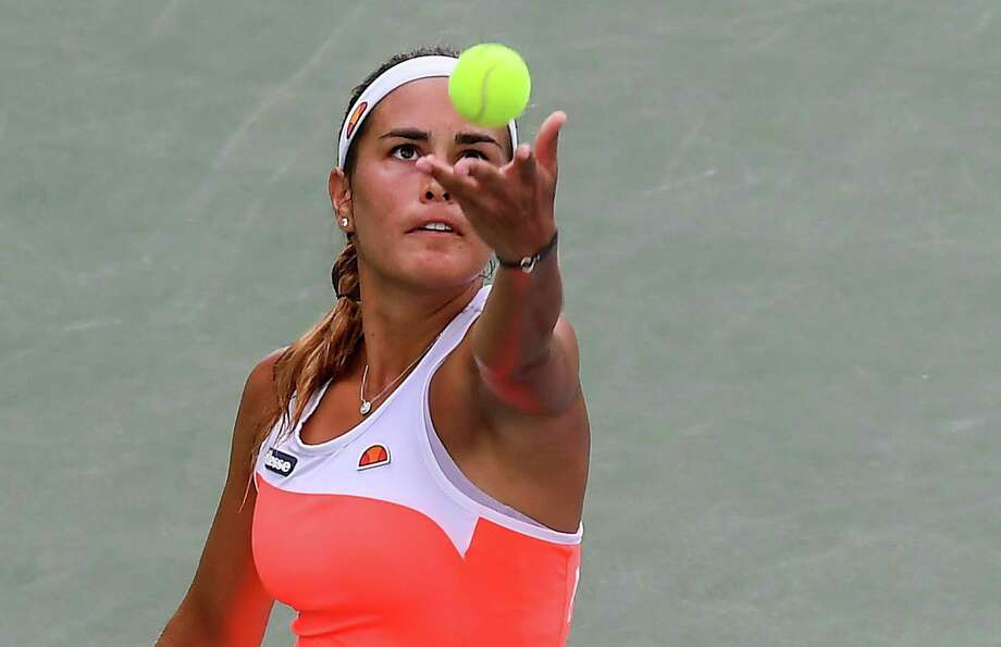 Monica Puig, seen here during a late-July match in Barranquilla, Colombia, advanced to the third round of Connecticut Open qualifying with a win on Saturday. Photo: Getty Images / AFP or licensors