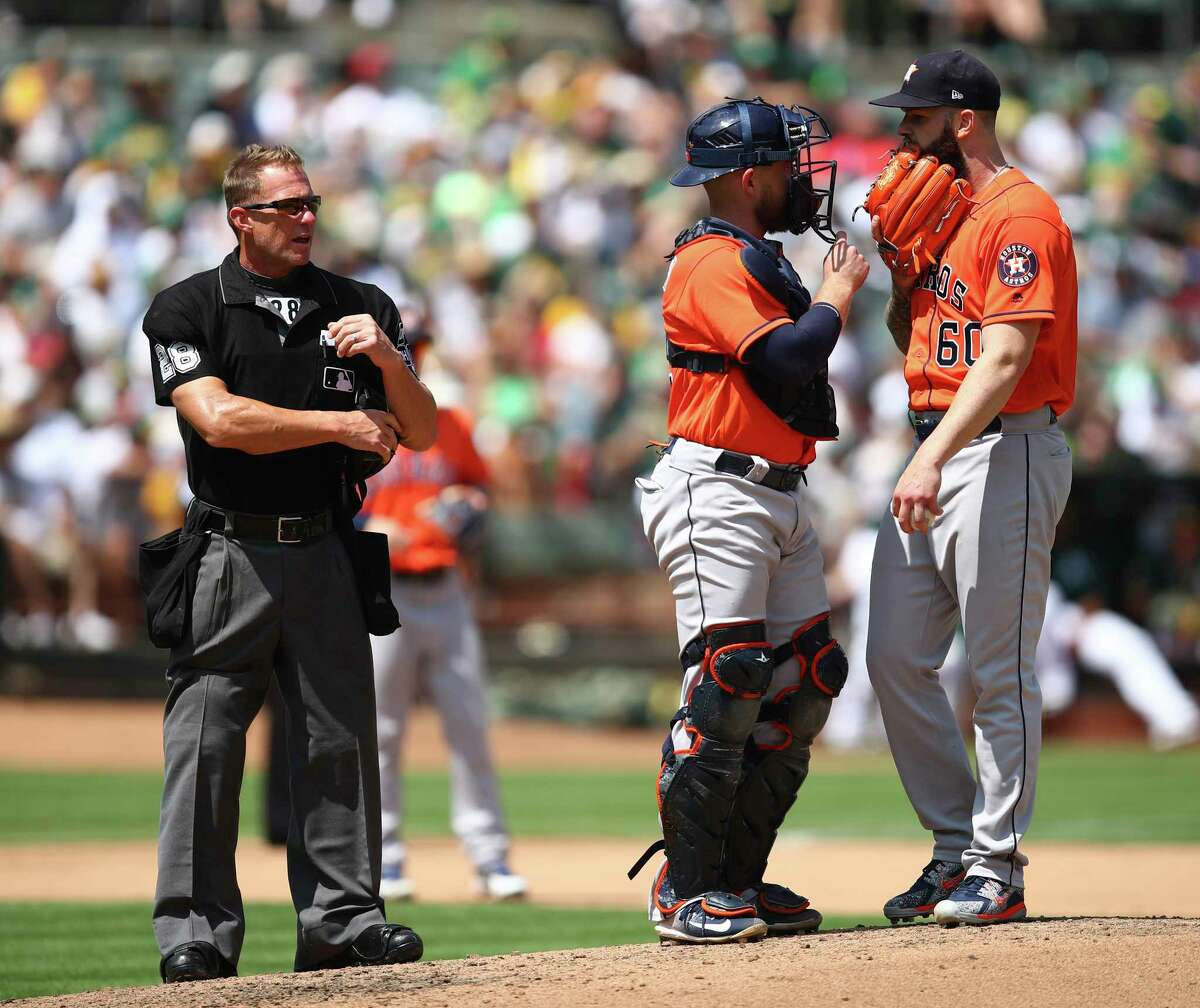 Houston Astros pitcher Dallas Keuchel, right, speaks with catcher Max Stassi in the fourth inning of a baseball game against the against the Oakland Athletics Saturday, Aug. 18, 2018, in Oakland, Calif. (AP Photo/Ben Margot)