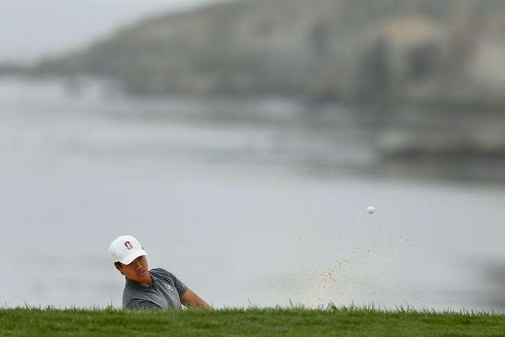 PEBBLE BEACH, CA - AUGUST 18: Isaiah Salinda of the United States plays a shot out of a bunker at the eighteenth green during the semi-final round of the U.S. Amateur Championship at Pebble Beach Golf Links on August 18, 2018 in Pebble Beach, California. (Photo by Lachlan Cunningham/Getty Images)