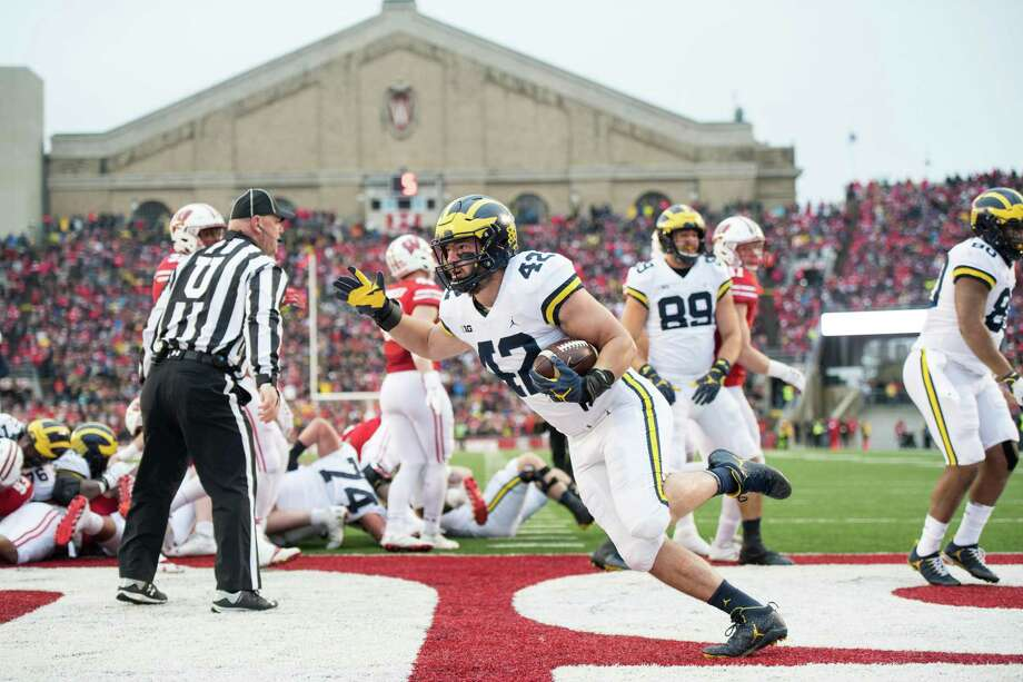 Newtown native Ben Mason rushed for a pair of touchdowns as a freshman at the University of Michigan. Photo: Eric Bronson / University Of Michigan Athletics / E.Bronson/Michigan Photography