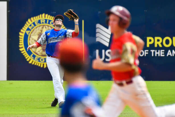 Berryhill leftfielder Seth Gower catches a flyball during Saturday's American Legion Baseball World Series win over Las Vegas, Nev.