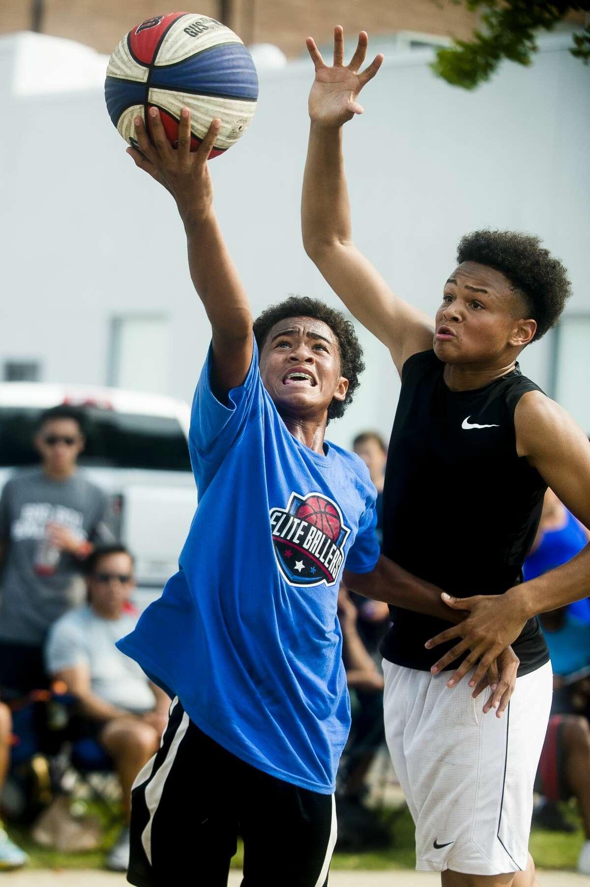 FILE - Chris Robinson of Lansing, 14, plays in the Gus Macker three-on-three basketball tournament in downtown Midlandon Saturday, Aug. 18, 2018. (Katy Kildee/kkildee@mdn.net)